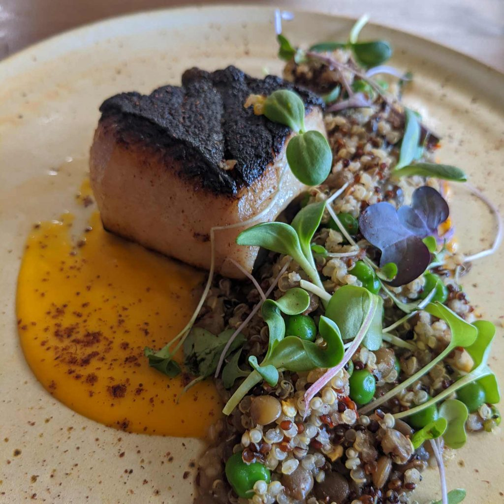 Sake Brined Sablefish, seared crispy on one side and plated with quinoa